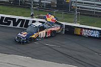 Mar 31, 2007; Martinsville, VA, USA; Nascar Craftsman Truck Series driver A.J. Allmendinger (00) crashes during the Kroger 250 at Martinsville Speedway. Mandatory Credit: Mark J. Rebilas...