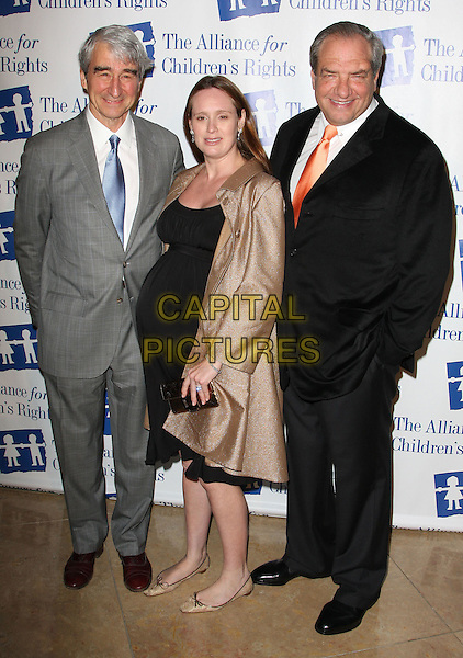 SAM WATERSTON, DICK WOLF & GUEST.Attending The Alliance for Children's Rights held At The Beverly Hilton Hotel, Beverly Hills, California, USA,.10th February 2010..full length grey gray suit blue tie pregnant gold coat black dress orange .CAP/ADM/KB. ©Kevan Brooks/AdMedia/Capital Pictures..