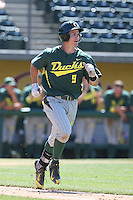 Scott Heineman (9) of the Oregon Ducks runs to first base during a game against the Southern California Trojans at Dedeaux Field on April 18, 2015 in Los Angeles, California. Oregon defeated Southern California, 15-4. (Larry Goren/Four Seam Images)