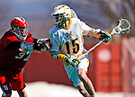 19 March 2011: University of Vermont Catamount Attacker/Midfielder Garrett Virtue, a Sophomore from Rye, NY, is checked by Midfielder Connor Mullen, a Freshman from Romansville, PA, during game action against the St. John's University Red Storm at Moulton Winder Field in Burlington, Vermont. The Catamounts defeated the visiting Red Storm 14-9. Mandatory Credit: Ed Wolfstein Photo