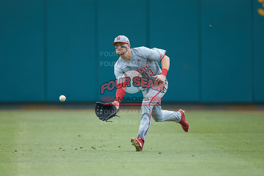 North Carolina State Wolfpack right fielder Brock Deatherage (13) tries to make the catch on this sinking line drive during the game against the Northeastern Huskies at Doak Field at Dail Park on June 2, 2018 in Raleigh, North Carolina. The Wolfpack defeated the Huskies 9-2. (Brian Westerholt/Four Seam Images)