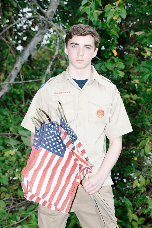 Portrait of Robert Mountain, age 17, an Eagle Scout candidate, in Belmont, Massachusetts, USA, on Sat., Oct. 14, 2017. Robert organized a flag retirement ceremony in Belmont, Massachusetts, USA, on Sat. Oct. 14, 2017. Flag retirement ceremonies are intended to give a dignified end to flags no longer fit to serve as a symbol for the United States of America. The ceremony was organized by Eagle Scout candidate Robert Mountain, 17, of Belmont Boy Scout Troop 66 as his Eagle Scout project.  The ceremony was held in park area surrounding Clay Pit Pond near Belmont High School.