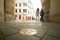 Europe, Slovakia, capitol city - Bratislava.Brass compass Rose inlaid under the medieval city gate of the Michael tower.