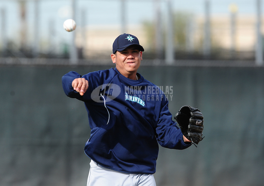 Feb. 15, 2012; Peoria, AZ, USA; Seattle Mariners pitcher Felix Hernandez throws during a pitchers and catchers workout at the Peoria Sports Complex.  Mandatory Credit: Mark J. Rebilas-.