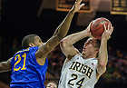 Dec. 7, 2013;  Notre Dame guard Pat Connaughton goes up for a shot as Delaware forward Marvin King-Davis  defends in the first half.  Photo by Barbara Johnston/University of Notre Dame