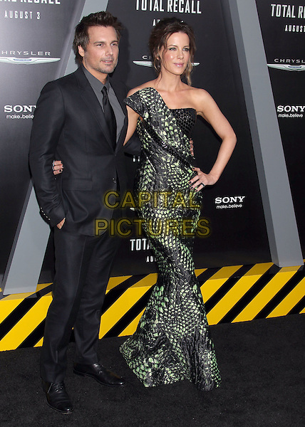 "Len Wiseman & Kate Beckinsale.""Total Recall"" Los Angeles Premiere held at Grauman's Chinese Theatre, Hollywood, California, USA..August 1st, 2012.full length dress grey gray shirt suit married husband wife black strapless green one shoulder snakeskin animal print paillettes hand in pocket hand on hip.CAP/ADM/RE.©Russ Elliot/AdMedia/Capital Pictures."