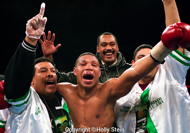 Julio Cesar Green celebrates after defeating Darren Obah by TKO in the 10th rd and wins the WBA miiddleweight title.