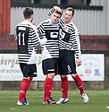 Shire's Jamie Glasgow (centre) celebrates with Max Wright (11) and David Greenhill (8) after he scores their second goal.