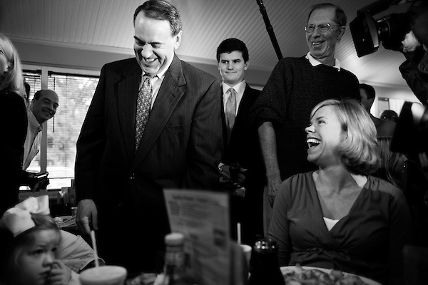 December 8, 2007. Columbia, SC.. Former Arkansas governor and presidential contender Mike Huckabee greeted diners at the Lizard's Thicket Restaurant in Columbia, SC, where he discussed his rise in the polls and the future of his campaign.. Huckabee greeted diners Lisa Vipperman, right, and her daughter Cameron.