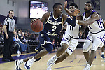 HIGH POINT, NC - JANUARY 06: Charleston Southern's Cortez Mitchell (2) drives past High Point's Denny Slay (11) and Brandonn Kamga (1). The High Point University of Panthers hosted the Charleston Southern University Buccaneers on January 6, 2018 at Millis Athletic Convocation Center in High Point, NC in a Division I men's college basketball game. HPU won the game 80-59.