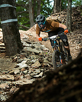 NWA Democrat-Gazette/BEN GOFF @NWABENGOFF<br /> Dan Maxwell competes in a stage Saturday, Aug. 18, 2018, during the Eureka Springs round of the Arkansas Enduro Series at Lake Leatherwood City Park. The event continues Sunday with stages at the Passion Play trails and an urban downhill leg through downtown Eureka Springs. The fifth and final race of the Arkansas Enduro Series season takes place Sept. 22 at the Coler Mountain Bike Preserve in Bentonville. Enduro is a type of mountain bike race with multiple time trial stages that are mostly downhill and technical. The downhill stages are linked together by untimed transition stages or shuttle buses.