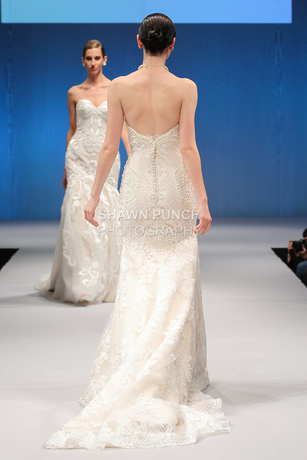Model walks runway in a bridal gown from the Jannifer Wu Australia bridal collection by Jannifer Wu, at the Designers Spotlight Pier 94 runway show on October 9, 2016; for New York International Bridal Week, during New York Bridal Fashion Week.