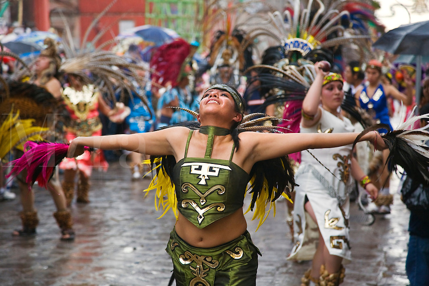 MEXICAN women dance in AZTEC INDIAN COSTUMES & FEATHERED HEADDRESSES in the FESTIVAL DE SAN MIGUEL ARCHANGEL PARADE - SAN MIGUEL DE ALLENDE, MEXICO