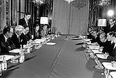 Paris, France - January 23, 1973 -- Both sides of the table at the ceremony initialling the Vietnam Peace Agreement in the International Conference Center in Paris France on Tuesday, January 23, 1973. Assistant to the President (Nixon) for National Security Affairs Henry A. Kissinger is third from the left and Le Duc Tho is third from the right.<br /> Credit: White House via CNP
