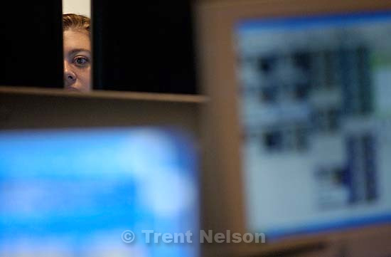 Dispatchers at the Utah County Sheriff's Office Dispatch Center respond to calls Tuesday afternoon. The center is understaffed by 25 percent. Low pay, high stress, and od work hours make it tough to attract and retain dispatchers.<br />