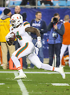 Charlotte, NC - December 2, 2017: Miami Hurricanes wide receiver Jeff Thomas (4) runs the ball during the ACC championship game between Miami and Clemson at Bank of America Stadium in Charlotte, NC.  (Photo by Elliott Brown/Media Images International) Clemson defeated Miami 38-3 for their third consecutive championship title.