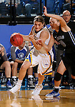BROOKINGS, SD - NOVEMBER 3:  Macy Miller #12 from South Dakota State drives against Rylie Osthus #10 from Dakota Wesleyan in the first half of their exhibition game Thursday night at Frost Arena. (Photo by Dave Eggen/Inertia)