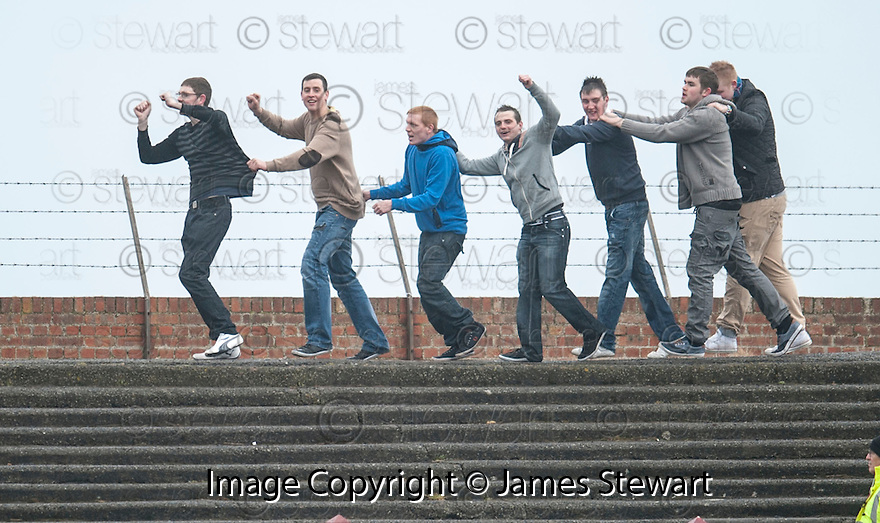 Queen of the South fans go for a conga around the ground.