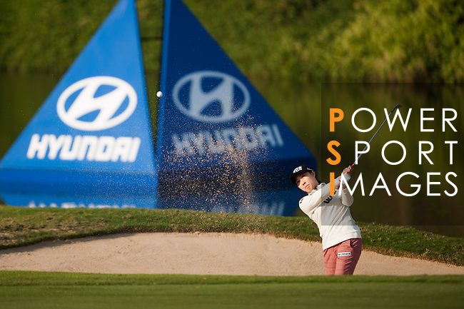 Player hits her shot during the Hyundai China Ladies Open 2014 at World Cup Course in Mission Hills Shenzhen on December 13 2014, in Shenzhen, China. Photo by Xaume Olleros / Power Sport Images
