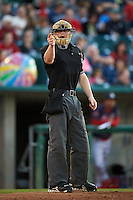 Umpire Thomas Roche makes a call during a game between the Peoria Chiefs and Lansing Lugnuts on June 6, 2015 at Cooley Law School Stadium in Lansing, Michigan.  Lansing defeated Peoria 6-2.  (Mike Janes/Four Seam Images)