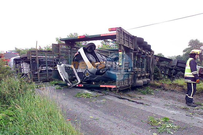 the scene of the accident on a slip road off the M1 moterway north of Drogheda, where a car transporter overturned while carying 5 new carsblocking the collon to Dunleer slip road. the slip road carries traffic from the N2 to the N1..Picture Fran Caffrey Newsfile...This Picture is sent to you by:..Newsfile Ltd.The View, Millmount Abbey, Drogheda, Co Louth, Ireland..Tel: +353419871240.Fax: +353419871260.GSM: +353862500958.ISDN: +353419871010.email: pictures@newsfile.ie.www.newsfile.ie