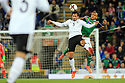 Northern Ireland's  Josh Magennis clashes with Germany's Mats Hummels during the FIFA World Cup 2018 Qualifying Group C qualifying soccer match between Northern Ireland and Germany at the National Football Stadium at Windsor Park, Belfast, Northern Ireland, 5 Oct 2017. Photo/Paul McErlane