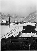 Looking east toward Telluride depot from the cab of a departing RGS freight train.  A bit of snow has fallen, but not enough to be a problem.<br /> RGS  Telluride, CO  Taken by Laube, Winfield G. - ca. 1930-1935