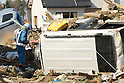 April 16, 2011, Sendai Airport, Sendai, Japan - Searchers look among debris of destroyed houses in the hopes of recovering documents and other items for survivors.(Photo by B.Meyer-Kenny/2.0 images)