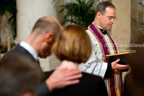 Father Paul Scalia leads a prayer during a private ceremony for his father United States Supreme Court Justice Antonin Scalia during a private ceremony in the Great Hall of the Supreme Court where late Supreme Court Justice Antonin Scalia lies in repose in Washington, DC Friday, February 19, 2016. <br /> Credit: Jacquelyn Martin / Pool via CNP