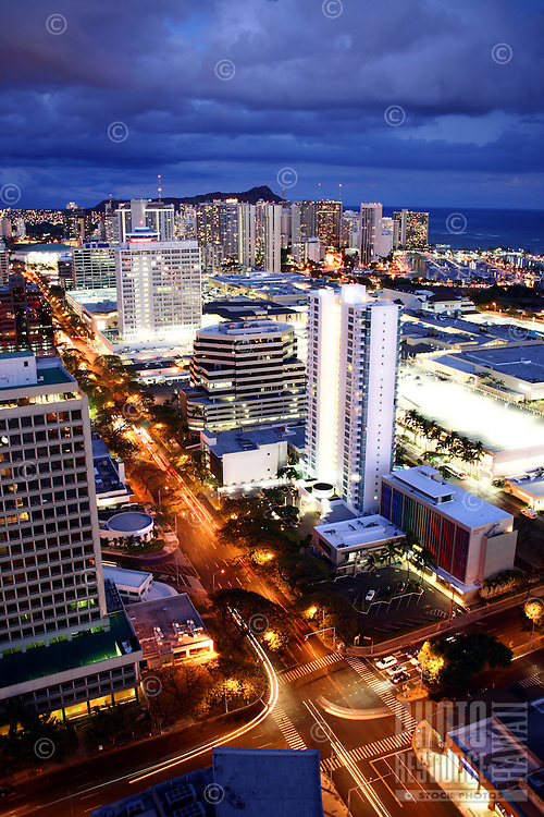 A view of Honolulu right after sunset from the top of Moana Pacific's West Tower, with Kapi'olani Boulevard at center, O'ahu.