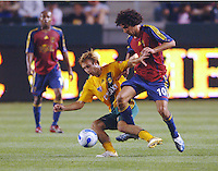 Los Angeles Galaxy's Michael Enfield steals the ball from Real Salt Lake's (10) Mehdi Ballouchy in the first half at the Home Depot Center in Carson, CA on Saturday, May 13, 2006. RSL defeated L.A. 3-0.
