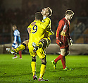 Queen of the South's Iain Russell (right) celebrates with Derek Lyle (9) after he scores their second goal.