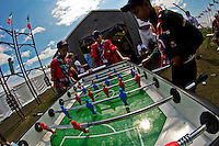 Yasser, Chakir and Farouk from Algeria are plaing a game of foozball outside the Italian Contingent Tent. Photo: Fredrik Sahlström/Scouterna