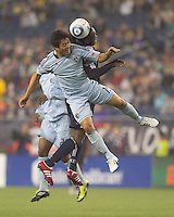 Sporting Kansas City defender Roger Espinoza (15) and New England Revolution midfielder Shalrie Joseph (21) battle for head ball. In a Major League Soccer (MLS) match, the New England Revolution defeated Sporting Kansas City, 3-2, at Gillette Stadium on April 23, 2011.