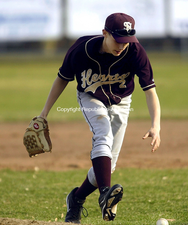 TORRINGTON, CT- 08 APRIL 2005-040805J05-- as Sacred Heart first baseman Bobby George scrambles to pick up a dropped ball during their season-opener game against Torrington Friday at Fuessenich Park in Torrrington --- Jim Shannon Photo--Torrington; Bobby George; Sacred Heart; Fuessenich Park are CQ