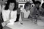 """Brian May, Roger Taylor and John Deacon of Queen attend Queen Press Conference for """"Hot Space"""" at Crazy Eddie's on July 27, 1982  in New York City."""