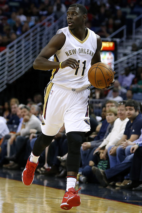 New Orleans Pelicans guard Jrue Holiday (11) drives with the ball during the first half of an NBA basketball game Saturday, Feb. 27, 2016, in New Orleans. (AP Photo/Jonathan Bachman)