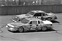 BROOKLYN, MI - AUGUST 11: Rusty Wallace (#2 Cliff Stewart Pontiac) leads Neil Bonnett (#12 Junior Johnson Chevrolet) during the Champion Spark Plug 400 NASCAR Winston Cup race at the Michigan International Speedway near Brooklyn, Michigan, on August 11, 1985.