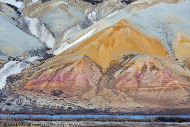 Colorful rock on the face of the Franklin Bluffs in Alaska's Arctic North Slope.
