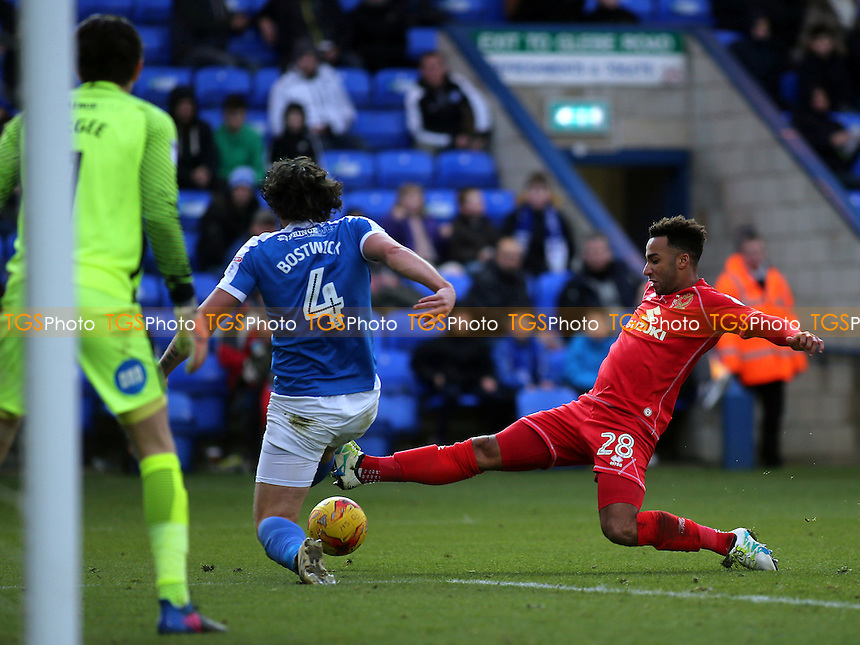 Nicky Maynard of MK Dons tackles Peterborough's Michael Bostwick during Peterborough United vs MK Dons, Sky Bet EFL League 1 Football at London Road on 28th January 2017