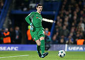 5th December 2017, Stamford Bridge, London, England; UEFA Champions League football, Chelsea versus Atletico Madrid; Goalkeeper Thibaut Courtois of Chelsea puts the ball back into play