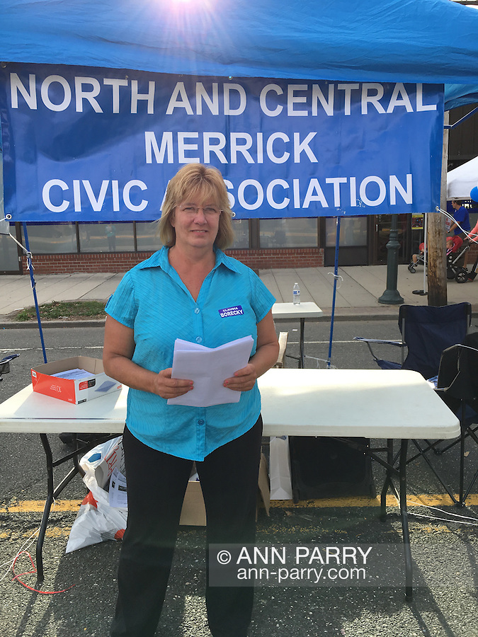 Merrick, New York, USA. September 26, 2015. Claudia Borecky, President of North and Central Merrick Civic Association at the NCMCA booth at the Merrick Chamber of Commerce Fall Festival.