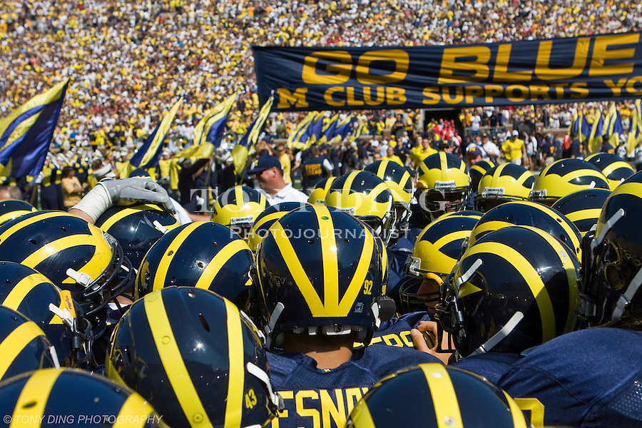 30 August 2008: Michigan players huddle before an NCAA college football game between the Michigan Wolverines and the Utah Utes, at Michigan Stadium in Ann Arbor, Michigan. Utah upset Michigan, winning 25-23.