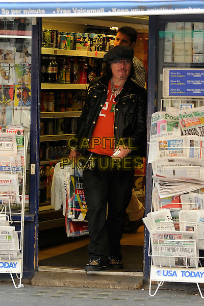 *Exclusive All-rounder*.Adam Ant (Stuart Lesley Goddard).Seen shopping in central London, England, UK, 19th August 2011..full length  red t-shirt glasses hat jacket cap jeans shop newsagents cigarette packet .CAP/IA.©Ian Allis/Capital Pictures.