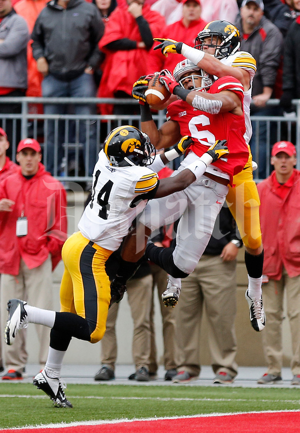 Ohio State Buckeyes wide receiver Evan Spencer (6) fails to catch a touchdown pass under pressure from Iowa Hawkeyes defensive back Desmond King (14) and Iowa Hawkeyes defensive back John Lowdermilk (37) in the second quarter of the NCAA football game between the Ohio State Buckeyes and the Iowa Hawkeyes at Ohio Stadium in Columbus, Saturday afternoon, October 19, 2013. The Ohio State Buckeyes defeated the Iowa Hawkeyes 34 - 24. (The Columbus Dispatch / Eamon Queeney)