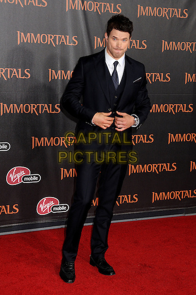 "Kellan Lutz.""Immortals"" World Premiere held at Nokia Theatre LA Live, Los Angeles, California, USA..November 7th, 2011.full length white shirt blue suit waistcoat hands  .CAP/ADM/BP.©Byron Purvis/AdMedia/Capital Pictures."