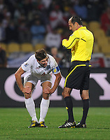 Referee Carlos Simon looks on as Steven Gerrard of England gets up slowly. USA tied England 1-1 in the 2010 FIFA World Cup at Royal Bafokeng Stadium in Rustenburg, South Africa on June 12, 2010.