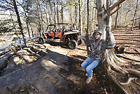 NWA Democrat-Gazette/FLIP PUTTHOFF <br /> Terry Kropf tries out a swing Dec. 21 2018 made from vines during stop in the Ozark National Forest.