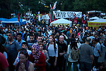 Gezi Park was full of people on the night before police raided it and forced demonstrators to leave, near Taksim Square, in Istanbul, Turkey, June 14, 2013. What started as a peaceful sit-in to save a small park near Taksim Square from being turned into a shopping mall has turned into large-scale anti-government demonstrations in cities across Turkey. In Istanbul, the protests have united communists, nationalists, anarchists, social liberals, and others unhappy with Prime Minister Recep Tayyip Erdogan's policies. Taking inspiration from the Occupy Wall Street movement in the United States, thousands of protesters have set up tents and are occupying the park in hopes of making their voices heard. Around 5000 injuries and five deaths have been reported since the Gezi Park sit-in began about two weeks ago.