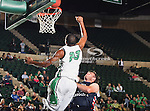 North Texas Mean Green guard Jordan Williams (23) and St. Gregory's Forward Brock Vorwald (50) in action during the NCAA  basketball game between the St. Gregory Cavilers and the University of North Texas Mean Green at the North Texas Coliseum,the Super Pit, in Denton, Texas. UNT defeated St. Gregory's 81 to 52...